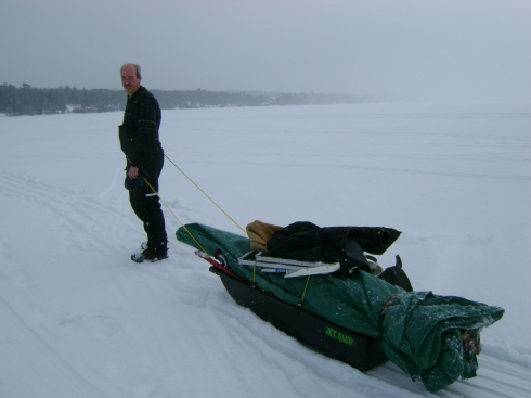 Barry pulling the sled off the ice