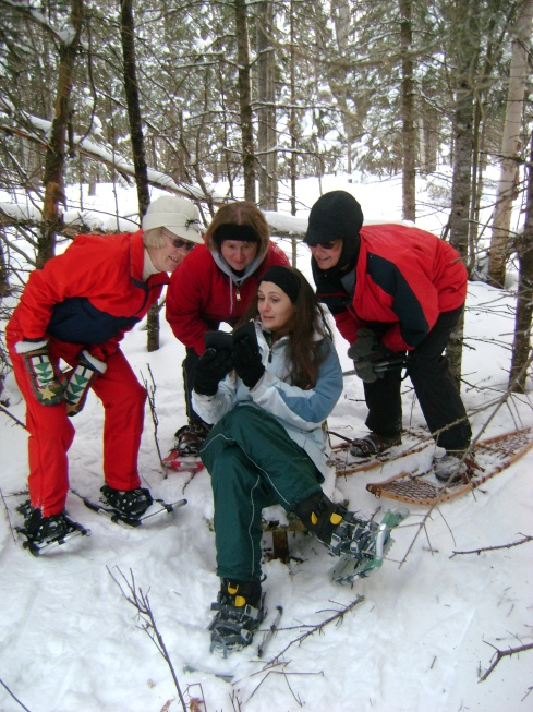 Snowshoeing book club members find chair in the middle of the woods!