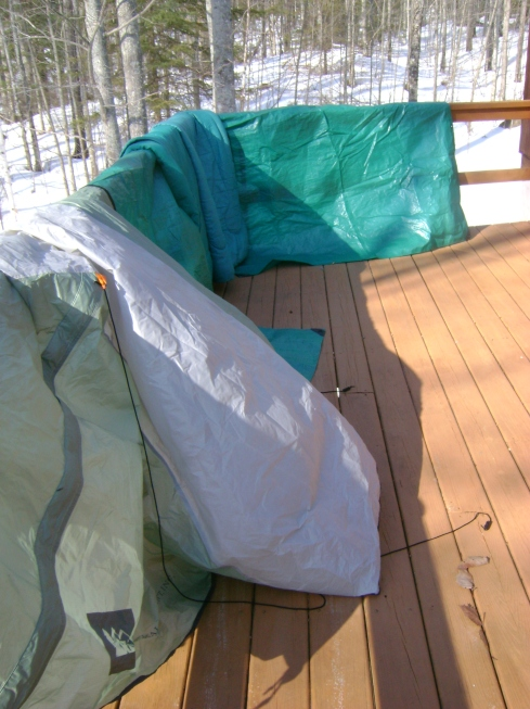 Tent, tarps & sleeping bags dry off in the breeze on our deck