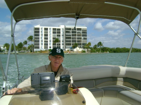 Captain Dale (with our condo directly behind the boat)