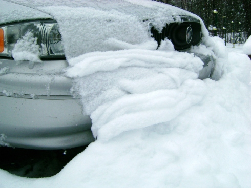 Look at the wet sloppy snow piled up around my car.  Not going anywhere today!
