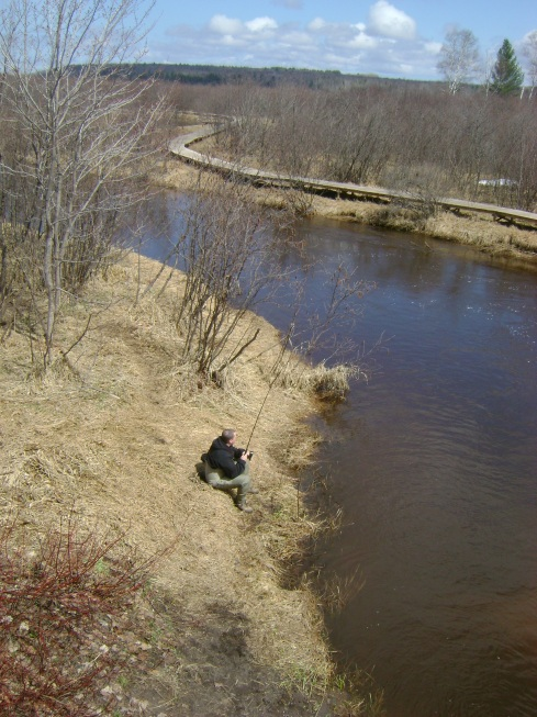 A steelhead fisherman plies the river