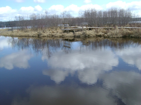 Clouds reflected in the river, with the Portage Canal up ahead