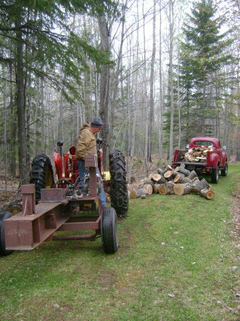 Wood splitter attached to tractor as we prepare to tackle small pile & throw in Studebaker