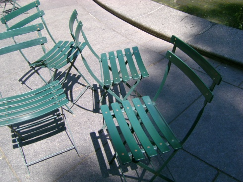 Green chairs in park