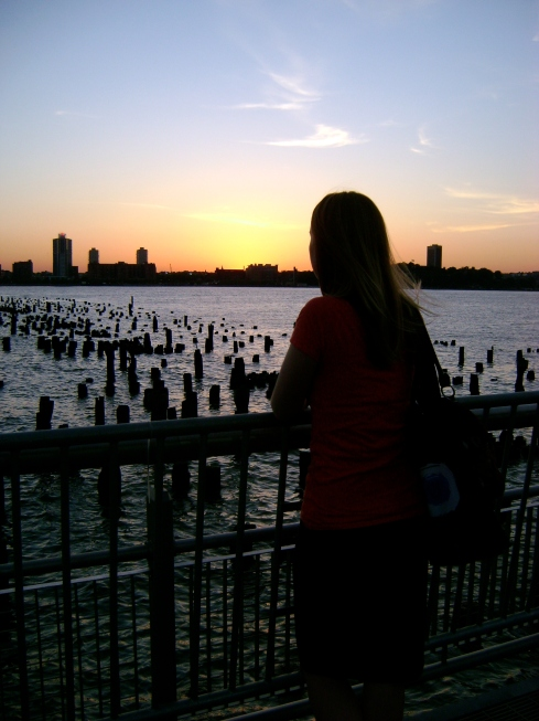 Kiah looking out over the pilings on the Hudson