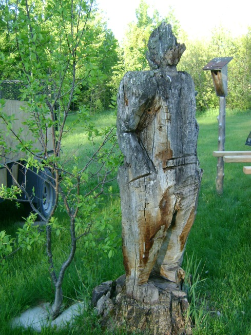 Old wooden carved fellow