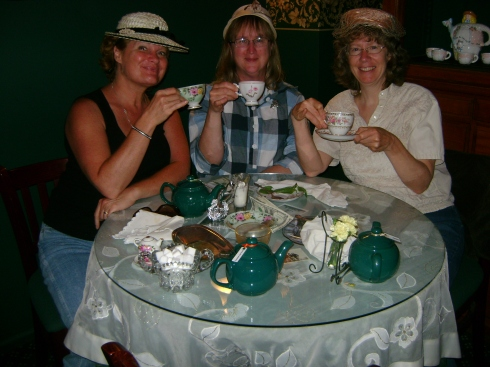 Jan, Joanne and Kathy with their little fingers up in the air like proper tea drinkers