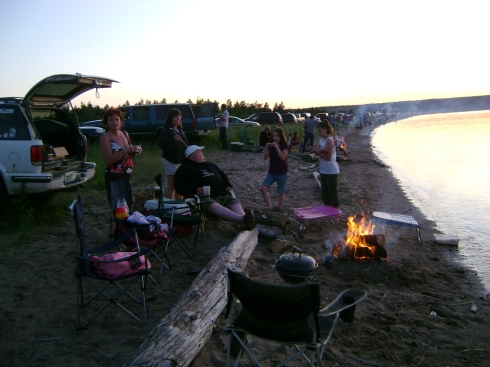 Family after family, campfire after campfire, as folks line up along the bay to watch the fireworks