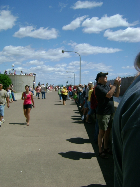 People lined up along the boardwalk, cameras in hand, breathless for...