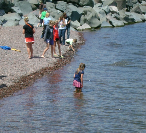 Little girl wades in Lake Superior