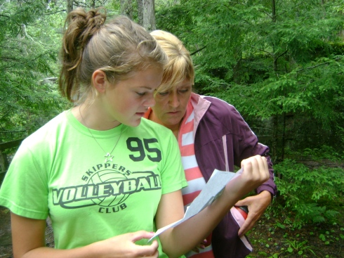 Keely and Karen study the clues