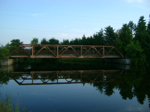 "Reflection of ""Third Bridge"" in water"