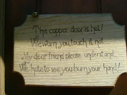 Sign on the Harbor Haus restaurant door.  Do not touch.