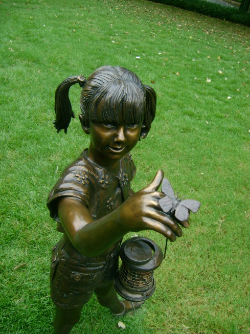 Bronze girl statue with butterfly