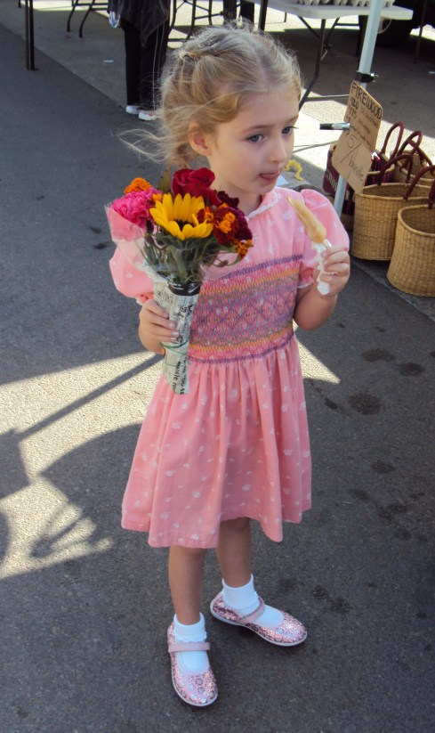 Little girl in pink with flowers